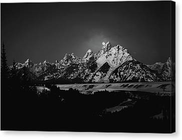 Full Moon Sets In The Teton Mountain Range Canvas Print