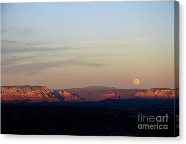 Full Moonrise Over Red Rocks Of Sedona Canvas Print by Ron Chilston
