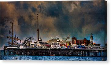 Funfair On The Pier Canvas Print by Chris Lord