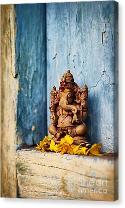 Sacred Canvas Print - Ganesha Statue And Flower Petals by Tim Gainey