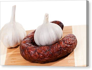 Kielbasa Canvas Print - Smoked Sausage And Two Garlic Bulbs  by Arletta Cwalina