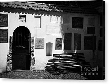 Gate Bench And Nameplate Memorials To Jewish Families Including Those Killed During The Holocaust In English And Hebrew In Remuh Cemetary In Krakow Canvas Print by Joe Fox