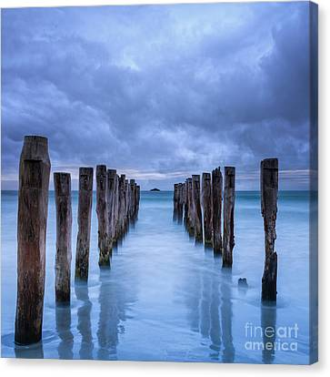 Gathering Storm Clouds Over Old Jetty Canvas Print by Colin and Linda McKie