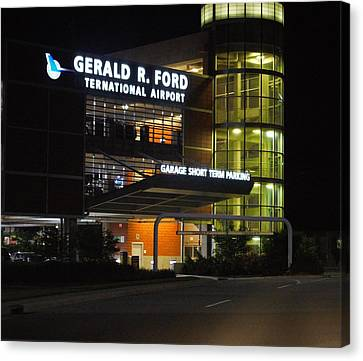 Gerald R Ford Airport In The Black Of Night Canvas Print by Rosemarie E Seppala