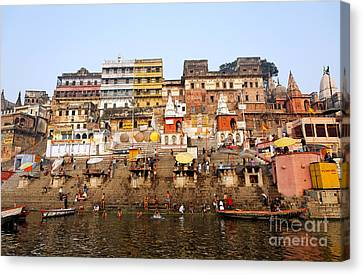 Ghats In The River Ganges At Varanasi In India Canvas Print by Robert Preston