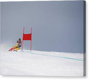 Giant Slalom Skier Rounds Gate At High Canvas Print