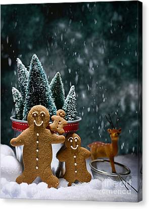 Gingerbread Family In Snow Canvas Print by Amanda Elwell