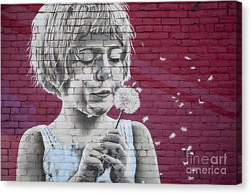 Girl Blowing A Dandelion Canvas Print