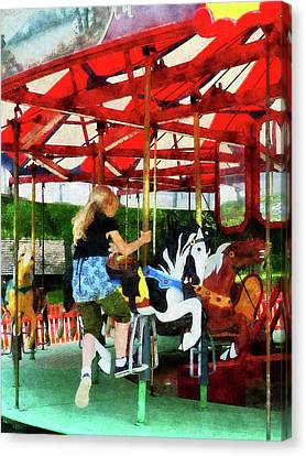 Girl Getting On Merry-go-round Canvas Print by Susan Savad