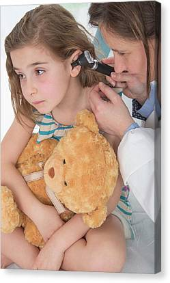 Girl Having Her Ears Examined Canvas Print