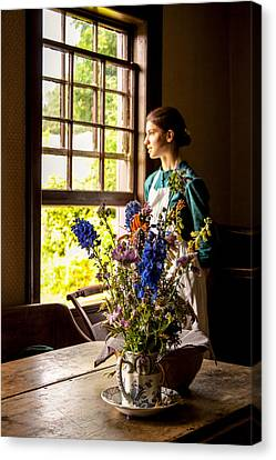 Canvas Print featuring the photograph Girl Looking Through An Open Window  by Levin Rodriguez