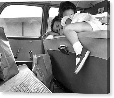 Girl Looks Into Backseat Canvas Print by Retro Images Archive