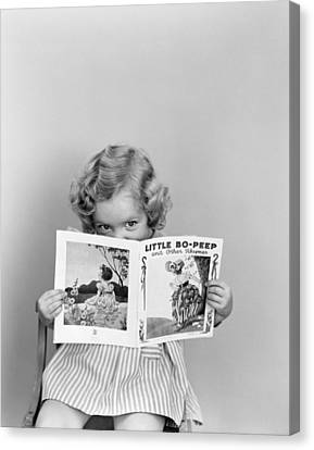 Girl Peeking Over Little Bo-peep Book Canvas Print by H. Armstrong Roberts/ClassicStock