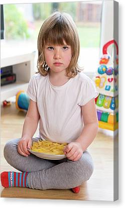 Girl Sitting On Floor With French Fries Canvas Print by Aberration Films Ltd