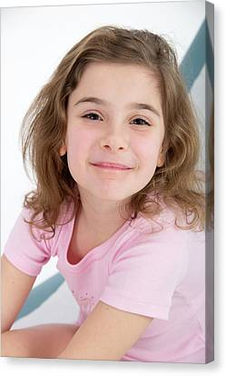 Girl Smiling Towards Camera Canvas Print