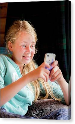 Girl Using A Smartphone Canvas Print