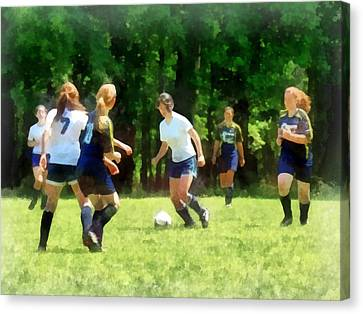 Girls Playing Soccer Canvas Print by Susan Savad