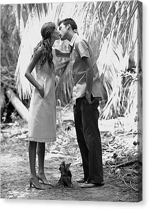 Gisele Bundchen Kissing A Young Man Canvas Print by Arthur Elgort