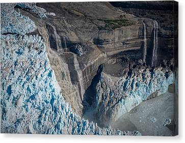 Glacier Icefall And Waterfalls Canvas Print by Roger Clifford