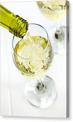 Glass Of White Wine Being Poured Canvas Print by Colin and Linda McKie