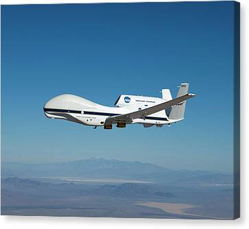 Global Hawk Unmanned Aerial Vehicle Canvas Print by Nasa/tom Miller