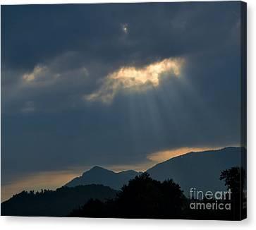 Gods Morning Rays Canvas Print by Eva Thomas