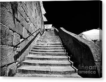Going Up In Porto Canvas Print by John Rizzuto