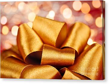 Wrapping Canvas Print - Gold Gift Bow With Festive Lights by Elena Elisseeva