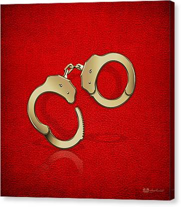 Gold Handcuffs On Red Leather Background Canvas Print