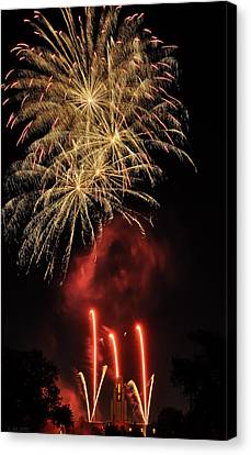 Golden Bursts And Ghostly Smoke Canvas Print by Kevin Munro