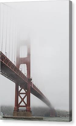 Golden Gate Bridge Shrouded In Fog Canvas Print by Adam Romanowicz
