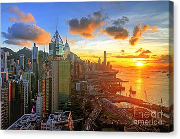 Golden Sunset In Hong Kong Canvas Print by Lars Ruecker