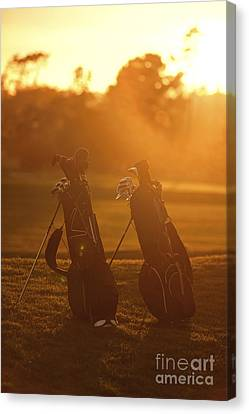Golf Bags At Sunset Canvas Print
