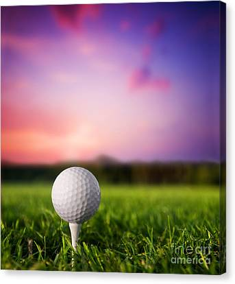 Golf Ball On Tee At Sunset Canvas Print