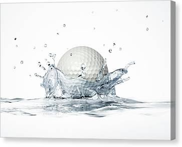 Golf Ball Canvas Print - Golf Ball Splashing Into Water by Leonello Calvetti
