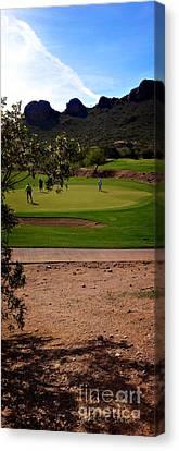 Golfing In The Desert Canvas Print by Nancy E Stein