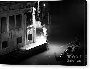 Gondola At Night On The Grand Canal Canvas Print by John Rizzuto