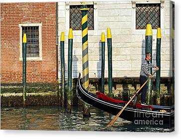 Gondola By Buildings On Grand Canal Canvas Print by Sami Sarkis