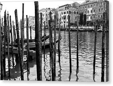 Gondola Dock On The Grand Canal Canvas Print by John Rizzuto