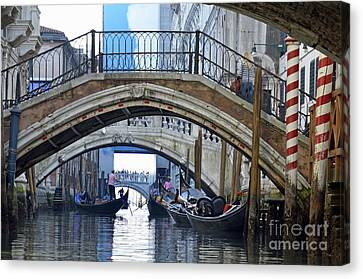 Gondolas And Bridges On Canal Canvas Print by Sami Sarkis