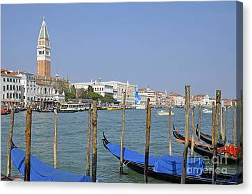 Gondolas At Pier By Grand Canal Canvas Print by Sami Sarkis