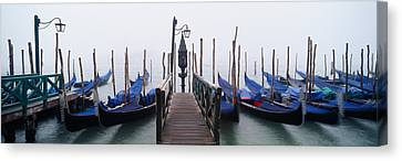Gondolas Moored In A Canal, Grand Canvas Print by Panoramic Images