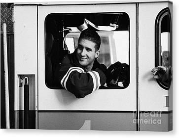 good looking male FDNY fireman looks back out of window of fire truck new york city Canvas Print by Joe Fox