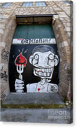 Graffiti On A Door Canvas Print by George Atsametakis