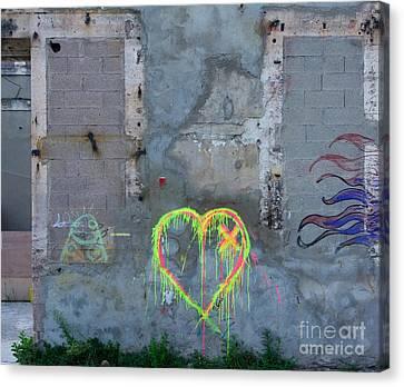Graffiti On A Wall Damaged. France. Europe. Canvas Print by Bernard Jaubert