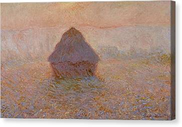 Grainstack  Sun In The Mist Canvas Print by Claude Monet