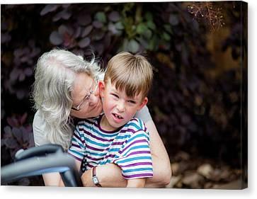 Grandmother Hugging Grandson Canvas Print by Samuel Ashfield