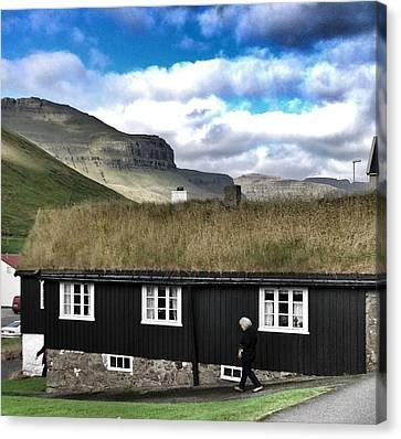 Grass Roof House In Faroe Islands Canvas Print by John Potts