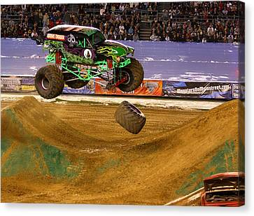 Canvas Print featuring the photograph Grave Digger Loses A Wheel by Nathan Rupert
