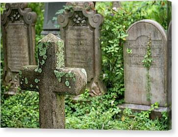 Gravestones At An Old Church Graveyard Canvas Print by Julien Mcroberts